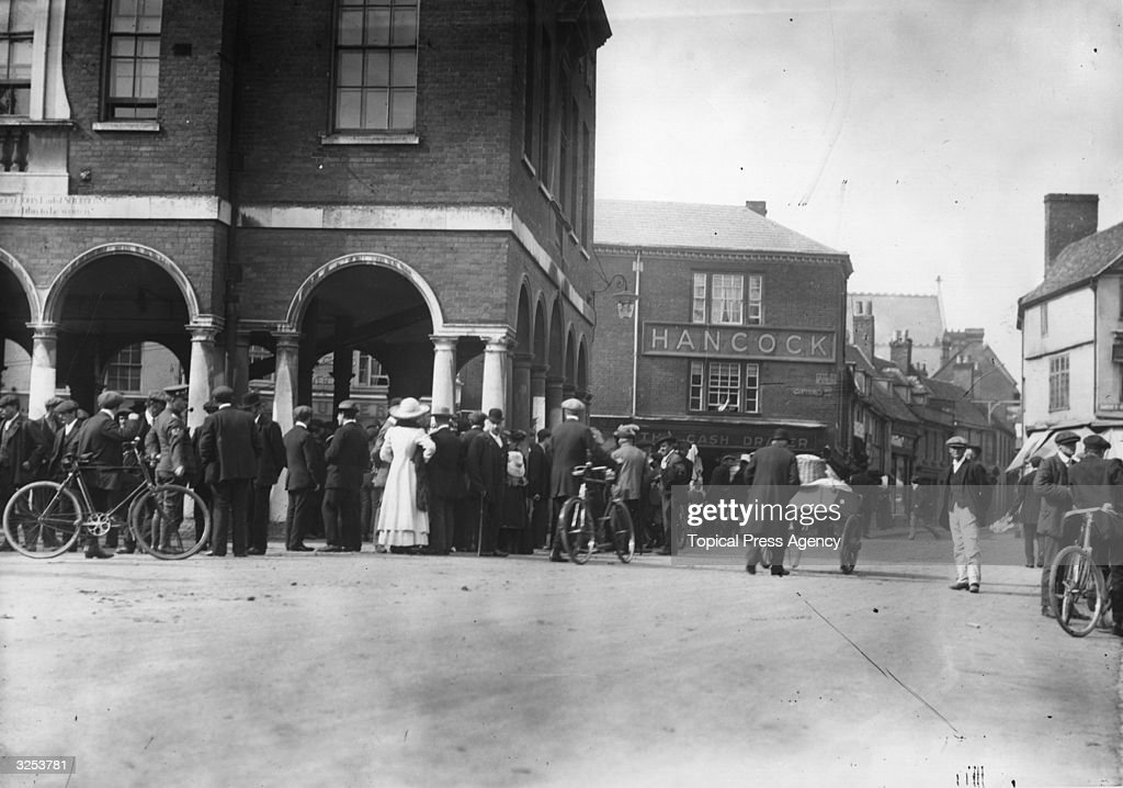 Farm hands wait in the market square to be taken on by new employers at the Michaelmas Hiring Fair High Wycombe 1912