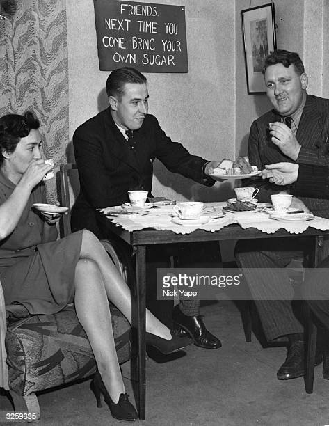 On the eve of the implementation of food rationing visitors to a Manchester home are asked to bring their own sugar when they drop in for a cup of tea