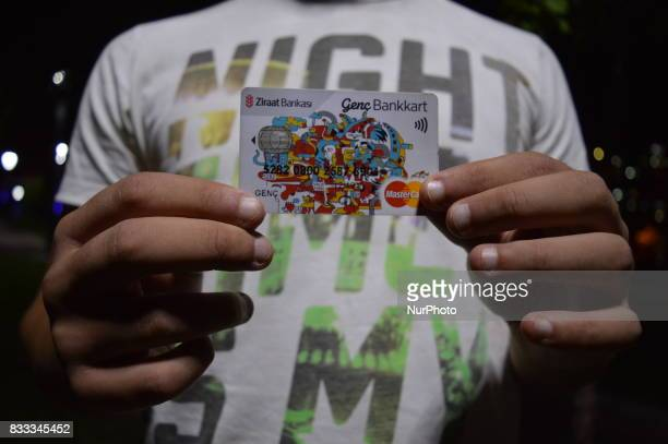 A 23yearold unemployment man shows his credit card in Ankara Turkey on August 16 2017 Turkey's youth unemployment rate for people aged 1524 was 198...