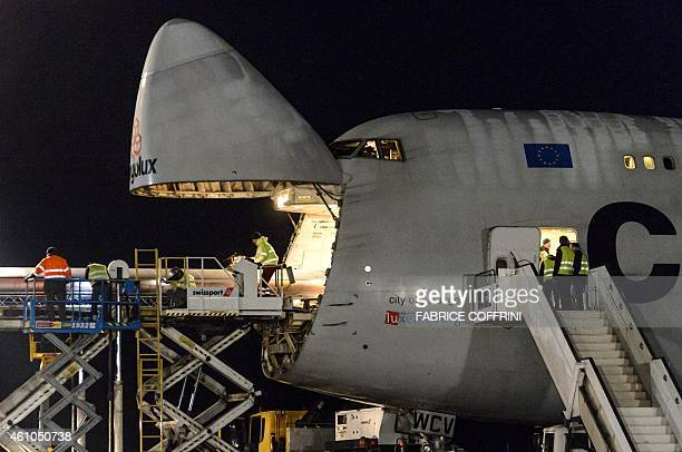 A 24m long wing element of solarpowered aircraft the Solar Impulse 2 is loaded to Cargolux Boeing 747 cargo aircraft on January 5 2015 at Payerne...