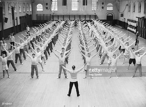 Public schoolboys from schools all over England who are members of the OTC being given free PT tuition by Army instructors at the Army School of...
