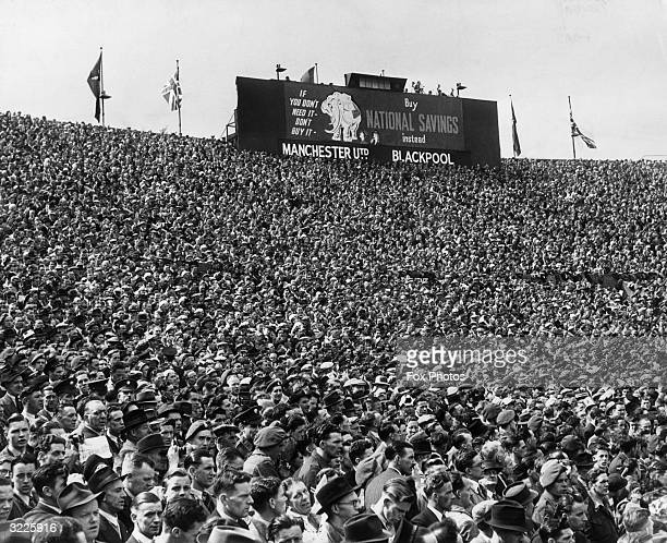 A section of the crowd at Wembley stadium watching the FA Cup Final between Manchester United and Blackpool