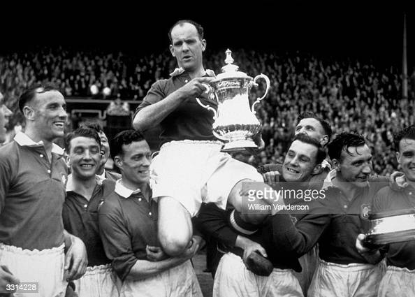 Manchester United captain Johnny Carey is carried shoulder high after his team beat Blackpool 42 in the FA Cup final at Wembley Stadium London