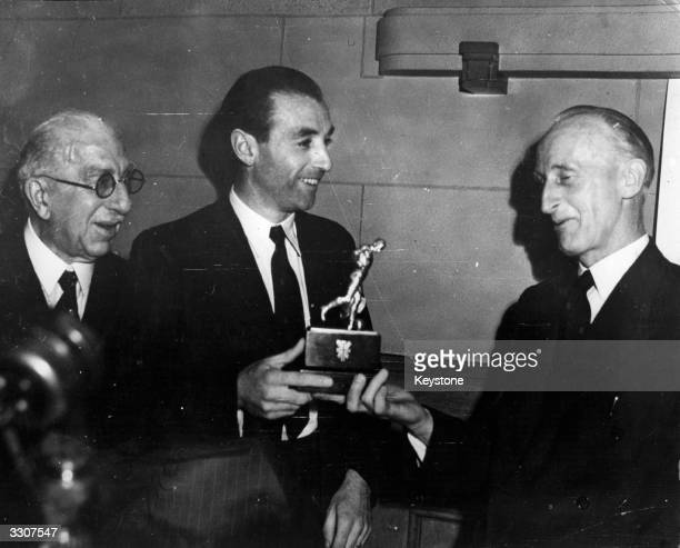 Stanley Matthews of Blackpool receives his award from journalist Ivan Sharpe after being voted the year's best footballer by newspaper sports writers