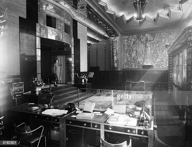 The reception desk in the front hall of the Daily Express building on London's Fleet Street The ornate basrelief was designed by Eric Aumonier and...