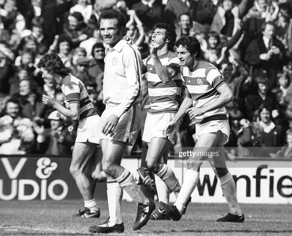 Queens Park Rangers players Thomas Clements and Frank McLintock celebrate the goal that Thomas scored to secure victory over Leeds United Leeds...