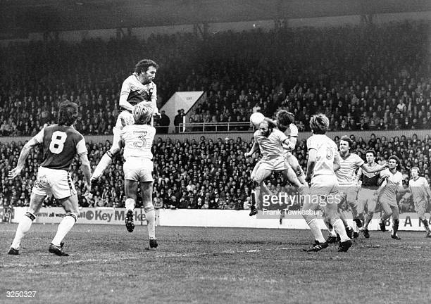 Birmingham City attempt to clear a West Ham United airborne attack by Trevor Brooking