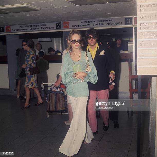 British fashion model Twiggy with her manager and boyfriend Justin de Villeneuve at London Airport en route to Greece