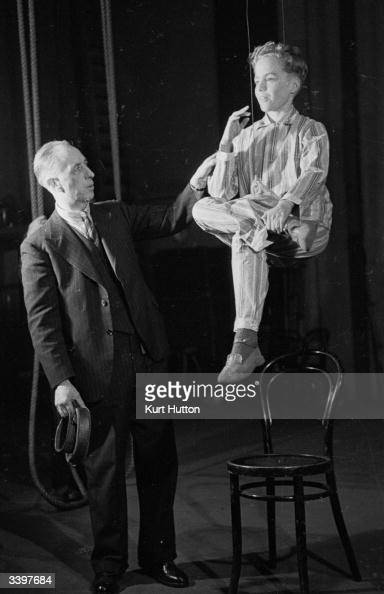 Stage effects expert Joseph Kirby introduces young actor John Gilpin to the use of the invisible wires that will enable him to 'fly' during a London...
