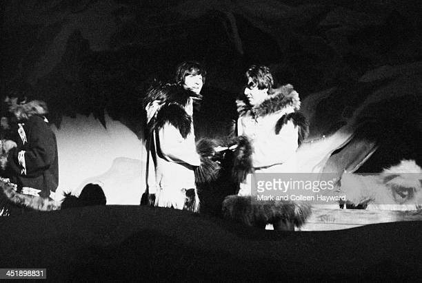 John Lennon and Paul McCartney from The Beatles perform a sketch dressed in 'Eskimo' costumes at 'Another Beatles Christmas Show' at Hammersmith...