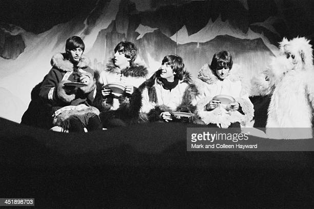 The Beatles perform a sketch dressed in 'Eskimo' costumes at 'Another Beatles Christmas Show' at Hammersmith Odeon in London on 24th December 1964...