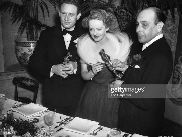 American film stars Spencer Tracy and Bette Davis accept their statuettes at the 1939 Academy Awards They won the Best Actor and Best Actress Oscars...