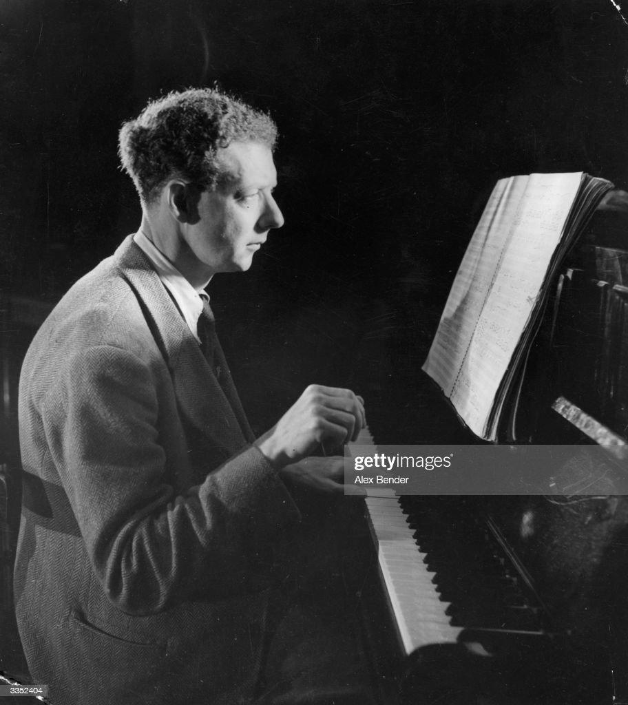 Benjamin (Edward) Britten, Baron Britten of Aldeburgh (1913 - 1976) playing the piano. Original Publication: Picture Post - 1924 - The Birth Of A New Opera - pub. 1945