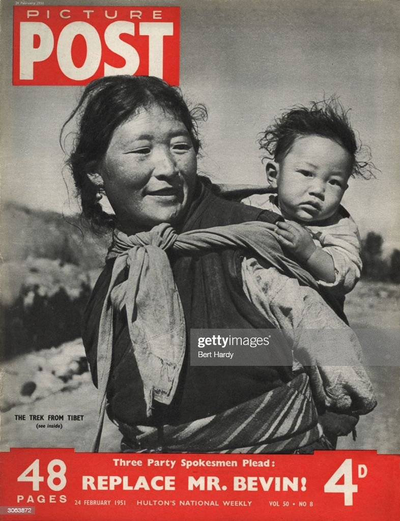 A Tibetan woman carries her child on her back as she heads toward Kalimpong, Bengal, fleeing the Chinese invasion of Tibet. The headline beneath reads 'Three Party Spokesmen Plead: Replace Mr Bevin!' Original Publication: Picture Post Cover - 5210 - Tibet Dissolves - pub. 1951