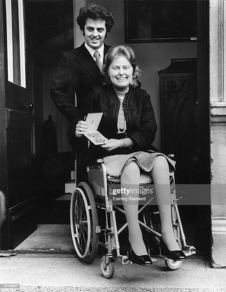 British cellist Jacqueline Du Pre (1945 - 1987) leaves Buckingham Palace with her husband, pianist <a gi-track='captionPersonalityLinkClicked' href=/galleries/search?phrase=Daniel+Barenboim&family=editorial&specificpeople=242823 ng-click='$event.stopPropagation()'>Daniel Barenboim</a>, after receiving an OBE from the Queen. She stopped performing in 1971, following the onset of multiple sclerosis.