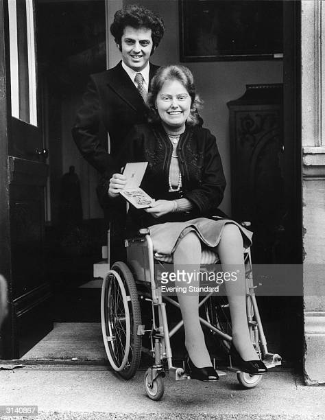 British cellist Jacqueline Du Pre leaves Buckingham Palace with her husband pianist Daniel Barenboim after receiving an OBE from the Queen She...