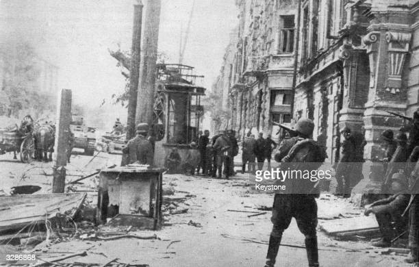 German soldiers fire the last shots in their mopping up operations in the main streets of Rostov It was their second conquest of the city where the...