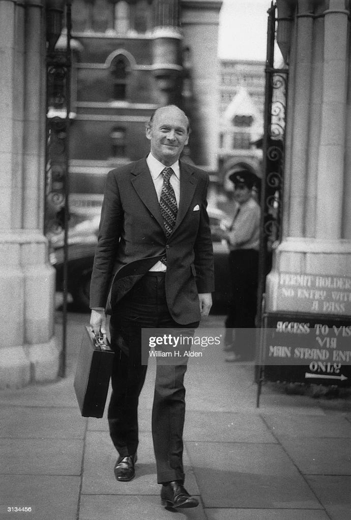 Cabinet Secretary Sir John Hunt outside the law courts on London's busy Strand