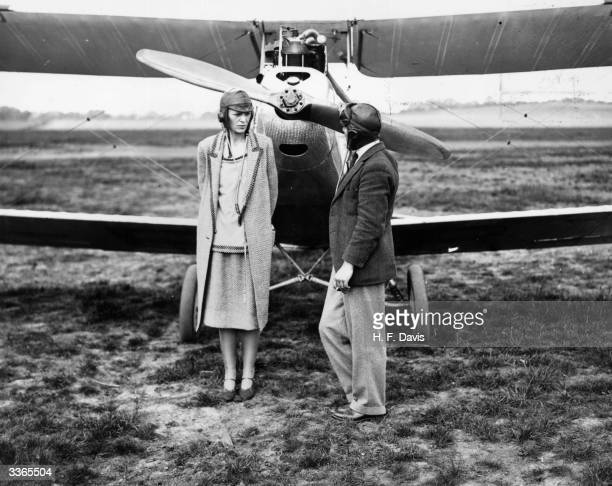 American aviator Amelia Earhart with her pilot Captain A H White after their trip to Northolt in a moth aircraft