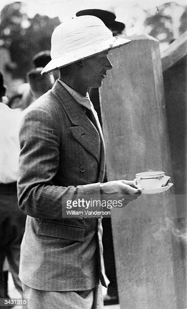 A spectator at Wimbledon wearing a pith helmet to keep cool