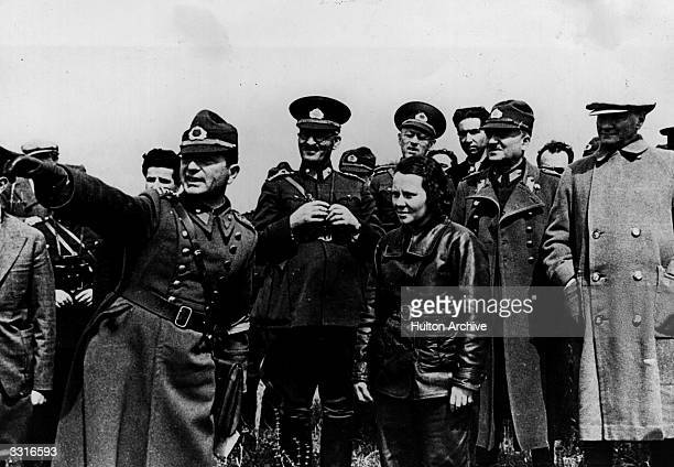 President Mustafa Kemal Ataturk of Turkey with his generals officers and a Turkish airwoman watch military manoeuvres over the Dardanelles