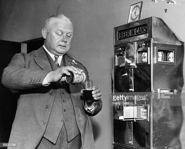 A canned beer machine being tested out in London The customer inserts 6d waits for the coin to drop and pulls out a sealed can of beer Experiments...