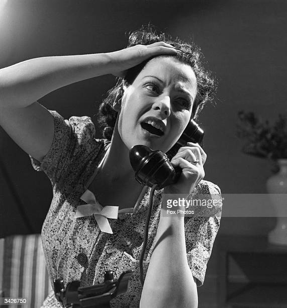 An exasperated woman cries for help on the phone