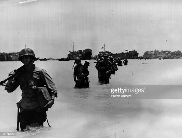 These soldiers landing from LST's are reinforcements for the already established beachhead at Saipan Island