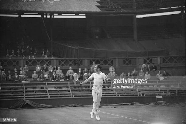 British tennis player D W Butler in action against D Scharenguivel on Centre Court during the first Wimbledon Lawn Tennis Championships since World...