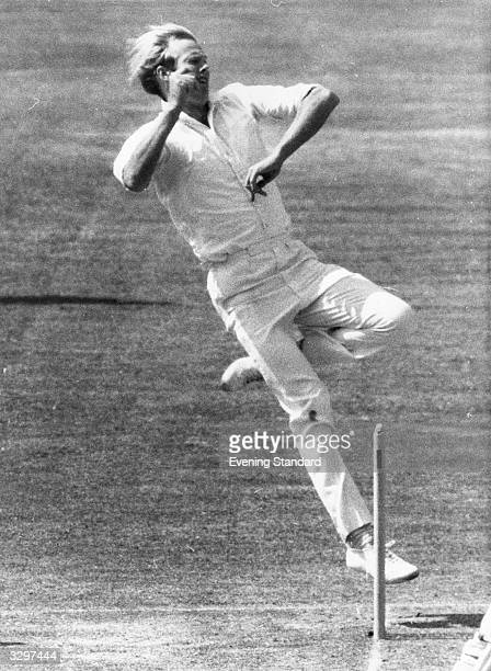 Sussex and England cricketer T Greig in action