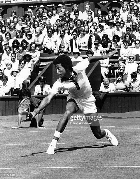 American tennis player Arthur Ashe in action against R Hewitt at Wimbledon in a four set match which he won