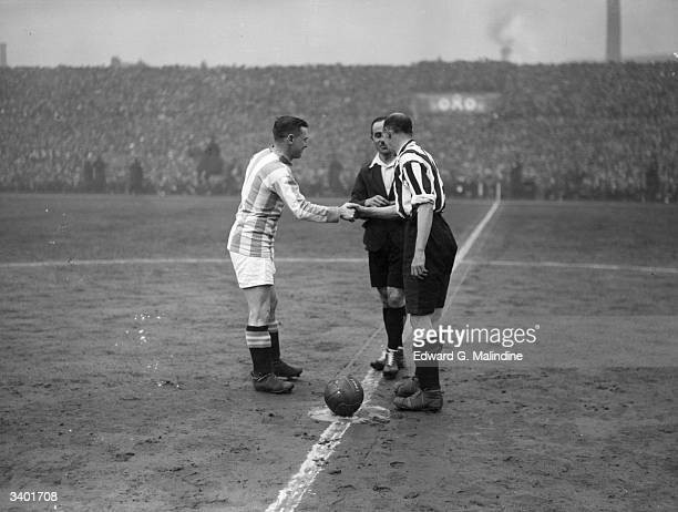Huddersfield Town captain Clem Stephenson and Sheffield United captain W Gillespie shake hands before the kick off the FA Cup semi final at Manchester