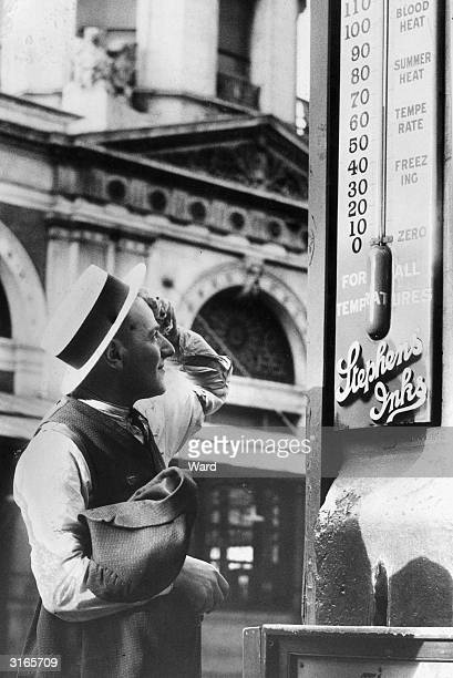 Too warm for March for the passer by who is mopping his brow as he reads a thermometer in Smithfield Market London which reads 70 fahrenheit