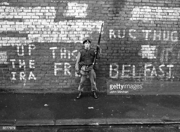 An armed British soldier on patrol in Belfast