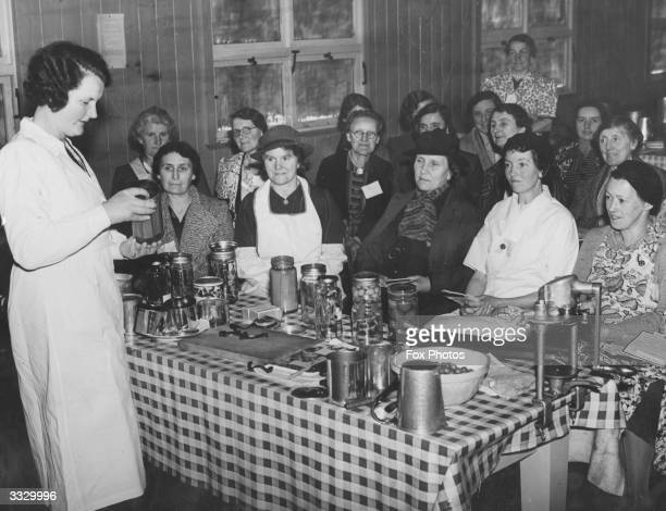 Miss B A Crang of Long Ashton Research centre lecturing members of the Women's Institute in Monmouthshire on methods of fruit and vegetable canning...