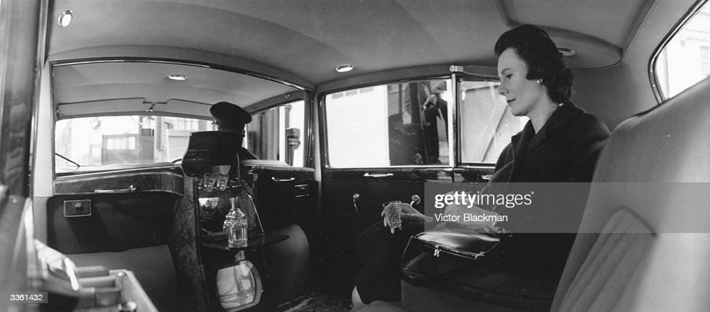 The interior of Queen Elizabeth the Queen Mother's car with a drinks cabinet and television.