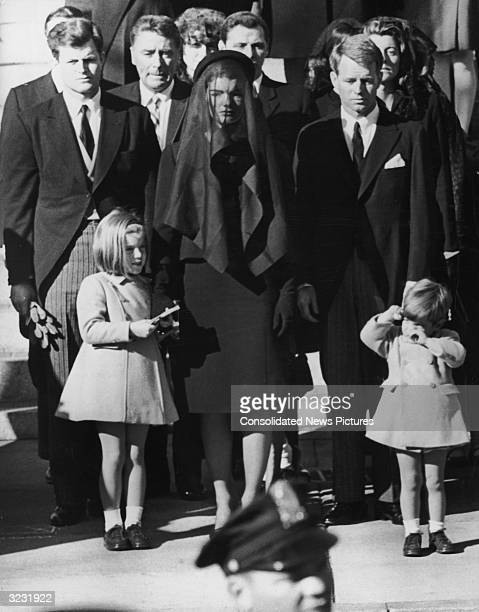 Jacqueline Kennedy stands with her children Caroline and John Jr and her brothersinlaw Senator Edward 'Ted' Kennedy and US Attorney General Robert...