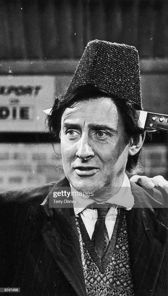 Spike Milligan (1918 - 2002) in ITV's comedy series 'Curry And Chips'. He plays Kevin O'Grady, one of the workers at Lillicrap Ltd, makers of seaside novelties.