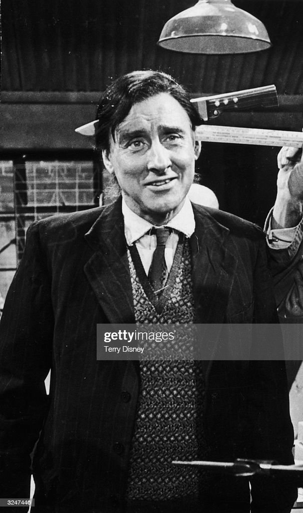 Spike Milligan (1918 - 2002), wearing a stage prop knife, playing Kevin O'Grady in a scene from ITV's comedy series 'Curry And Chips'.