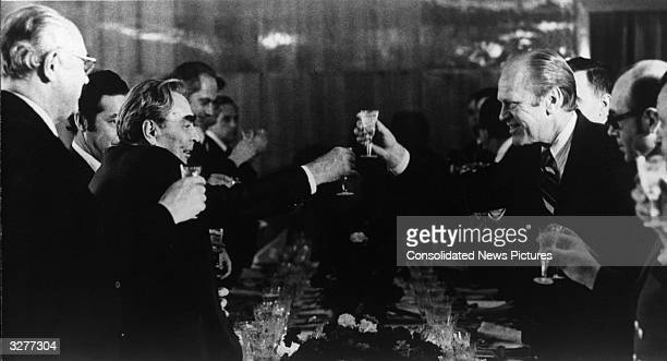 American statesman Gerald Ford the 38th President of the United States and Soviet leader Leonid Brezhnev share a toast at their final dinner at...