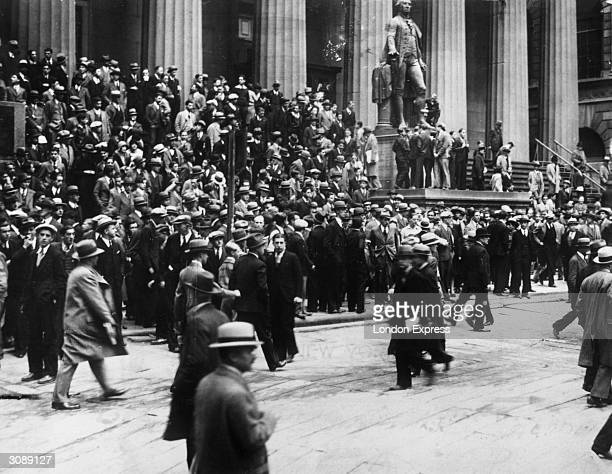 Huge crowds outside the sub Treasury Building watching the Wall Street Stock Exchange across the corner