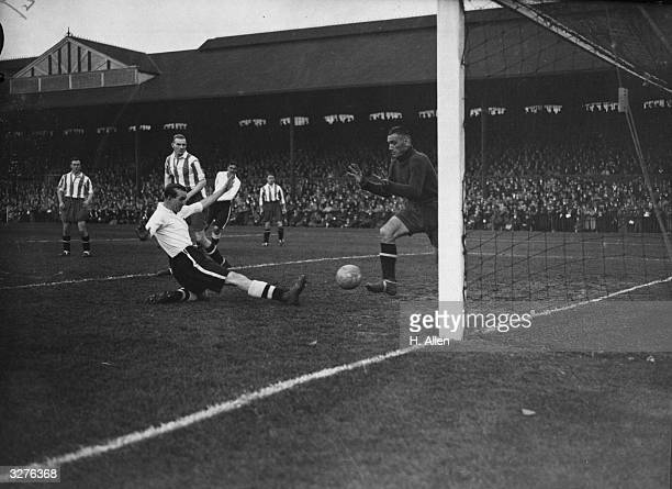 Perry scores Fulham's first goal playing against Bury at Craven Cottage London