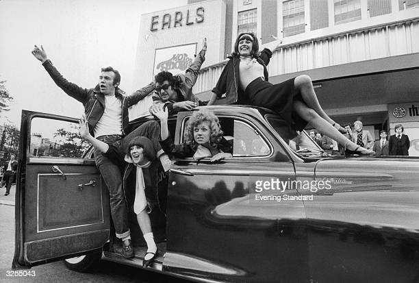The cast of the show 'Grease' a new 1950's rock and roll musical arrive at Earls Court London for the 1973 Motor Show driving a Chrysler Windsor...