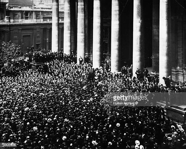 A crowd gathers at the Royal Exchange in London to hear the reading of the Royal Proclamation for the Dissolution of Parliament