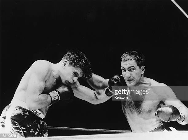 Rocky Marciano and Roland La Straza fight for the heavyweight title at the Polo Grounds in New York which Rocky won by a knock out in the 11th round