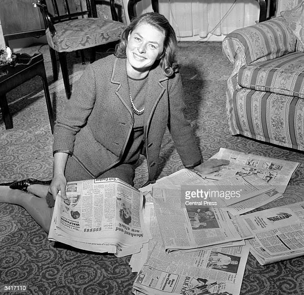 Swedish actress Ingrid Bergman reading her own reviews in the newspapers after appearing in Ivan Turgenev's 'A Month In The Country' at London's...