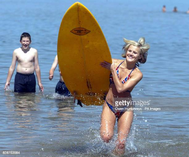 24yearold model and actress Helen Benoist enjoys the surf at Tynemouth beach Newcastle as Britain continues to enjoy another hot summers day