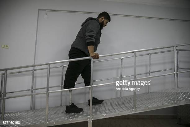24yearold Syrian refugee Muslim Muslim fled from Syria's Aleppo due to ongoing civilwar holds the fences as he receives physiotherapy at a medical...