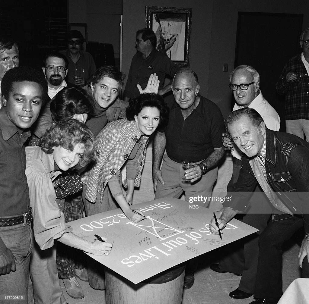 LIVES -- 2500th Episode Party -- Pictured: Cast and crew during the 2500 episode party (l-r) Lawrence Cook, Corinne Conley, Bill Hayes (waving), Susan Seaforth Hayes, writer William J. Bell, unknown, Mark Tapscott --