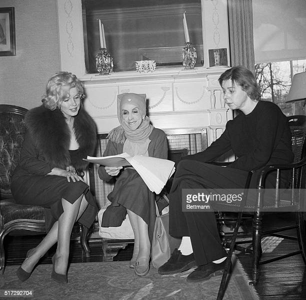 2/5/59Nyack New York Actress Marilyn Monroe watches as famed Danish author Isak Dinesen examines a manuscript at the home of US writer Carson...